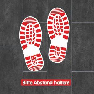 Bodenaufkleber mit Schuhabdruck und Abstand halten